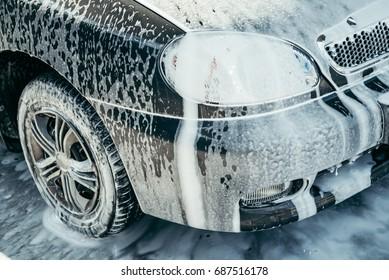 car in foam on carwash, car cleaning