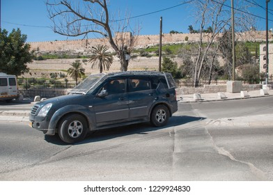 Car fortified with a protective grid on the streets of Jerusalem. Arab-Israeli conflict
