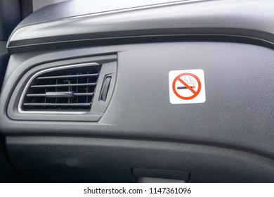 Car Front Console or Dashboard with No Smoking Sign Sticker on it