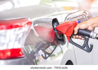 car fuel concept, Hand refilling the car with fuel at the refuel station