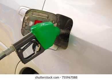 Car fuel up at gas station