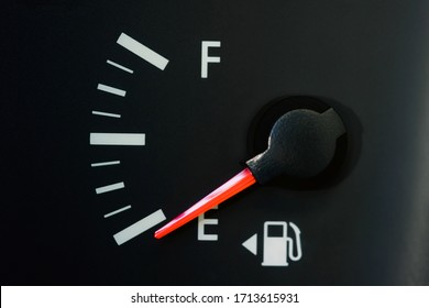 Car Fuel Gauge Showing Empty, close up