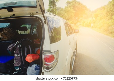 Car full of suitcases and bags to return from summer holidays. overloaded car of a car leaving for the travel