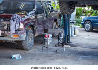 car in garage with special equipment prepared for repair