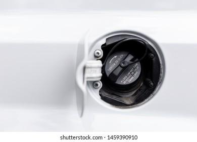 Car gas cap on a white vehicle