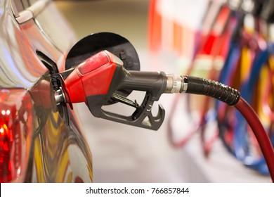 car at gas station .pump gas