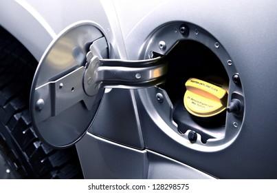 Car Gas Tank - Fueling Theme. Closeup. Transportation Photo Collection.