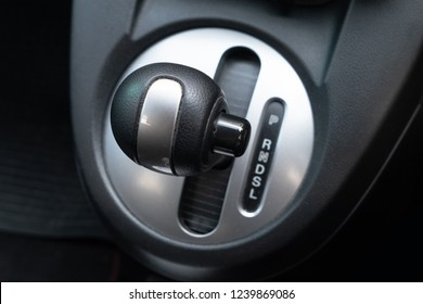 Car gearbox lever inside driver place.