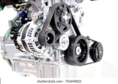 Car generator with drive belt on white background.
