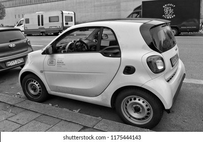 A car from a German car rental company car2go on Munich street. Carsharing service. Small city car. Smart Fortwo. Black and White Photography. Germany, Munich – November 18, 2017