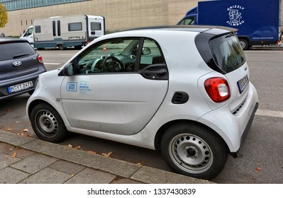 A car from a German car rental company car2go on Munich street. Carsharing service. Small city car. Smart Fortwo. Germany, Munich – November 18, 2017