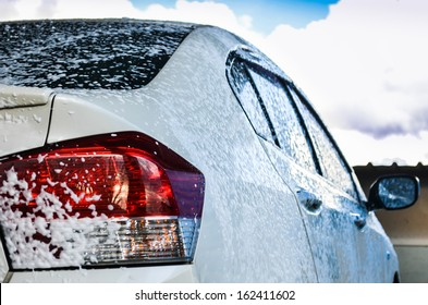 car getting a wash with soap