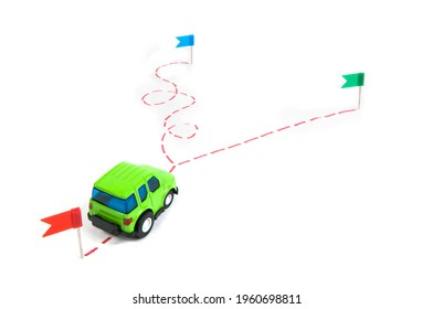 the car goes along a drawn route with a fork in the road, one road is long, the other road is short, the concept of choosing a short way to reach the goal.