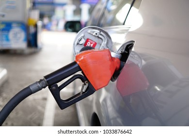 Car grey refueling on petrol station