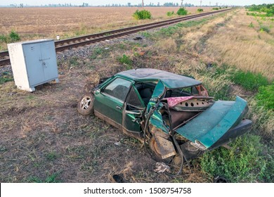 The car had an accident at a railway crossing. Passenger car collided with a train.