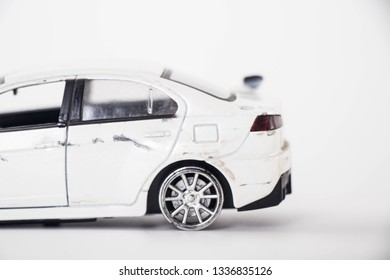 The car has a collision on a white background.