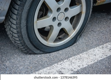 Car to have a flat tire on the road