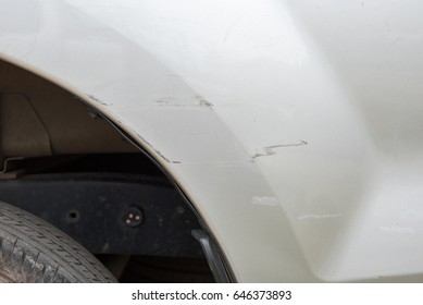 Car have scratched with deep damage to the paint,car accident on the road.