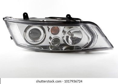 Car headlight with four lamps
