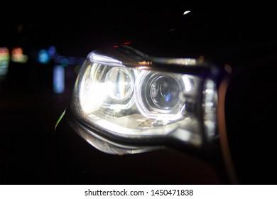 Car headlight at late night.