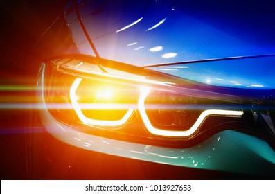 Car headlights. Exterior detail. Car luxury concept