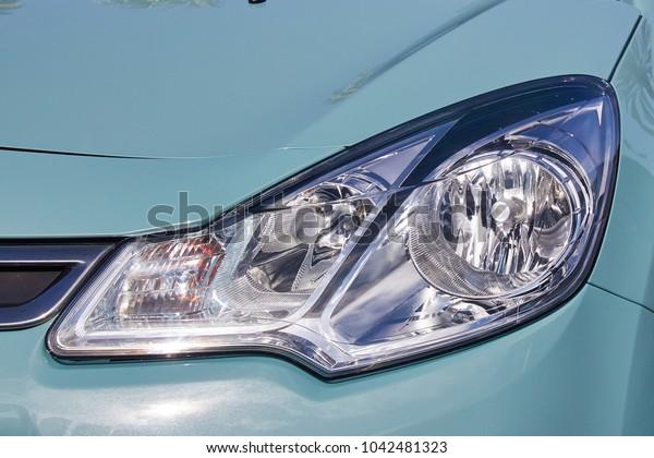 Car headlights in the sunlight