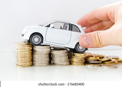 Car with helping hand on coins