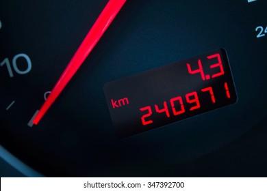 Car with a high mileage. Car dashboard in closeup