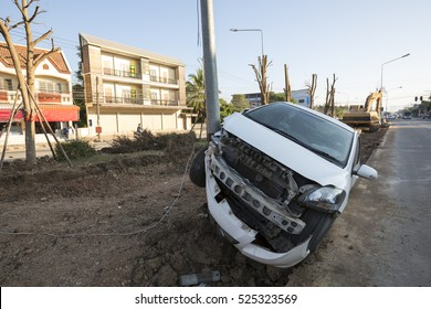 Car hit a power pole on a road construction site