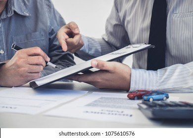 Car and Home insurance concept, broker agent presenting and consult to customer to decision making sign insurance form agreement, home and car model.