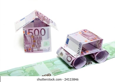 The car and the house made of euro,  isolated on a white background