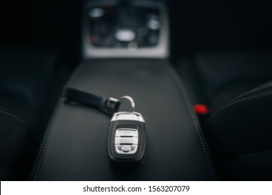 Car ignition key at the armrest