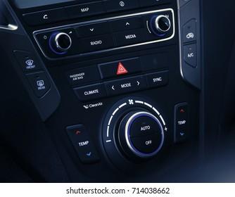 Car inside driver place. Interior of prestige modern car. Steering wheel, dashboard, display climate control