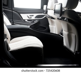 Car inside. Interior of prestige luxury modern car. Back seats with displays, isolated on white, clipping path included