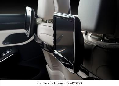Car inside. Interior of prestige luxury modern car. Back seats with displays