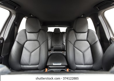 Car inside. Interior of prestige modern car. Comfortable leather seats. Black cockpit with on isolated white background.