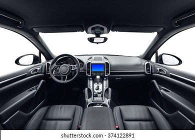 Car inside. Interior of prestige modern car. Front seats with steering wheel, dashboard & display. Black cockpit with wood & metal decoration on isolated white background.