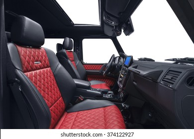Car inside passenger place. Interior of prestige modern car. Front seats with steering wheel, dashboard, gear shift & display. Black & red cockpit on isolated white background.