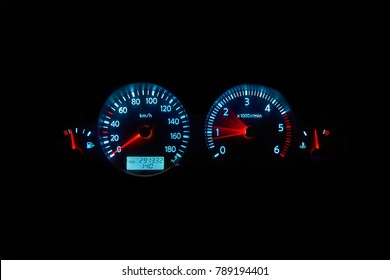 Car instrument panel. Disel vehicle dashboard on black bacground.