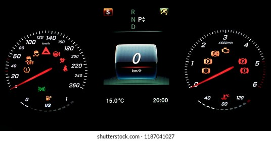A car instrument panel with speedometer, tachometer, odometer, fuel gauge, car's temperature gauge, TPMS icon, check engine, airbag and brake system icons. A photo on isolated background.