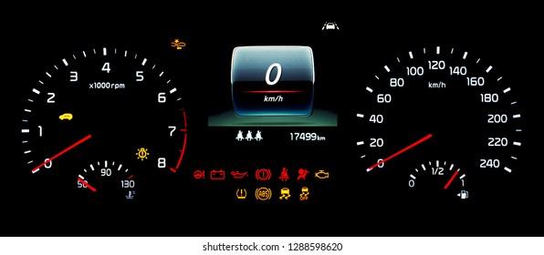 Car instrument panel with speedometer, tachometer, odometer, fuel gauge, oil temperature gauge, ABS, ESP, TPMS icon, check engine, airbag, brake system, seat belt reminder, lane assist warning light.