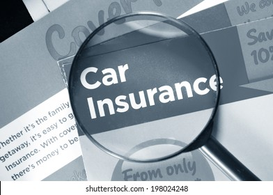 Car insurance and breakdown cover leaflets and glasses