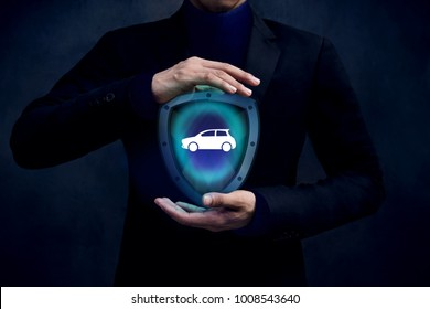 Car Insurance Company Safe and Supporting Customer Concept, Automobile icon inside a Shield Guard Protected and Careful Gesture Hands of Businessman