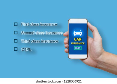 Car insurance concept and man hand holding smartphone.