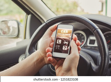 car insurance concept, person driver reading website on smartphone screen