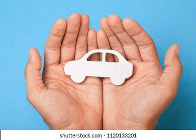 Car insurance. Man is holding car