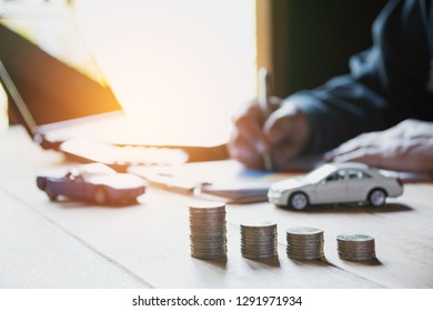 Car insurance and car service. Businesswoman and toy car, business and financial concept.