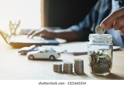 Car insurance and car service with stack of coins. Toy car for accounting and financial concept.