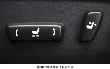 Car interior with buttons for adjusting seat position
