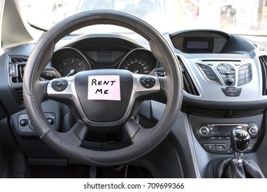 Car interior close-up. Rental sign. Rent me text.